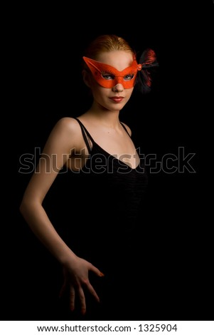 lady in red carnival mask inviting to dance - stock photo