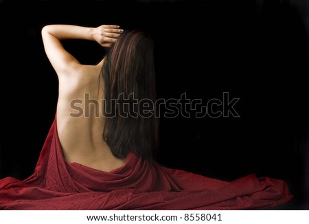 Lady in red cloth on black background - stock photo