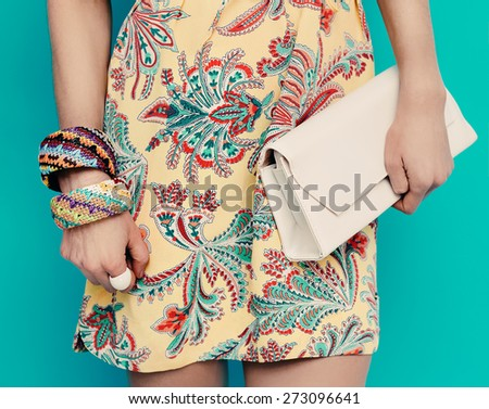Lady in stylish summer Dress and stylish Accessories. Bracelets and Clutch - stock photo