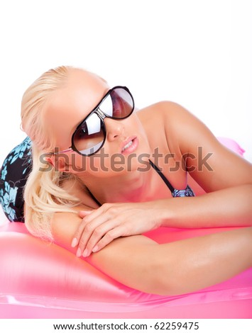 Lady in sunglasses and swimsuit