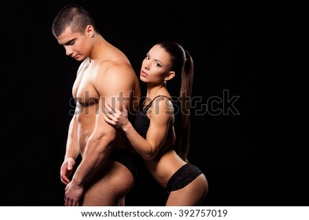 Lady in underwear hugging bodybuilder. Sexy fitness model hugs athlete. Let me feel your touch. Enjoy every minute. - stock photo