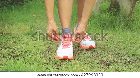 Lady is wearing footwear prepare to practice on yard