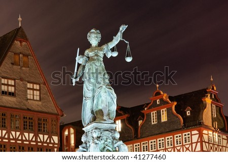 Lady Justice by night in Frankfurt. Germany.