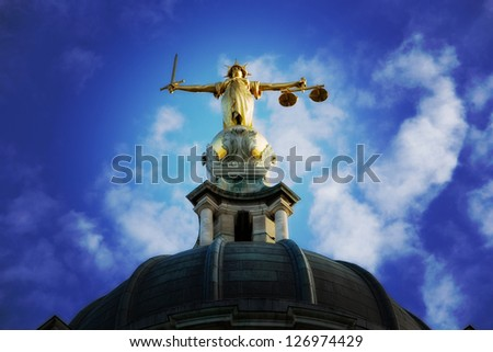 Lady Justice on top of the Old Bailey in London, England, processed with a Lomo style effect. - stock photo