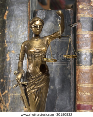 Lady of Justice on a background of ancient books
