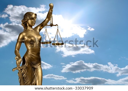 Lady of Justice on sky background - stock photo