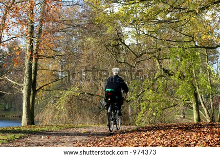 lady on a cycle in autumn in the countryside  in denmark