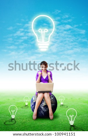 Lady on digital world got idea on grass field : Elements of this image furnished by NASA