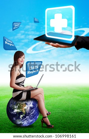 Lady on globe and First Aid icon on touch pad : Elements of this image furnished by NASA - stock photo