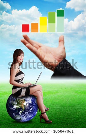 Lady on globe and Graph report on the hand : Elements of this image furnished by NASA - stock photo