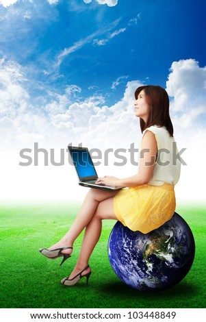 Lady on globe look at the blue sky : Elements of this image furnished by NASA