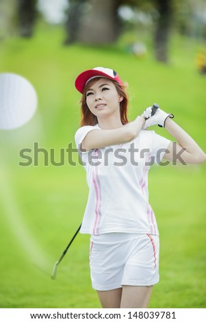 lady playing and golf swing with smile - stock photo