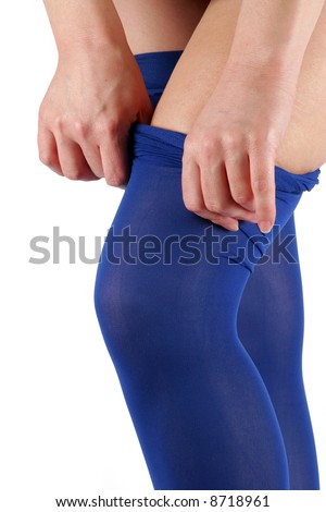 Lady pulling blue tights on her sexy legs