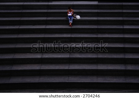 Lady readin a book on steps in London - stock photo