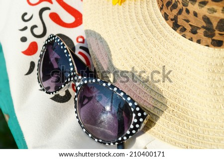 lady's bag with the words I love Ukraine glasses hat - stock photo