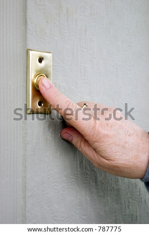 Lady's finger pushing a door bell push button - stock photo