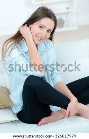 Lady sat on couch