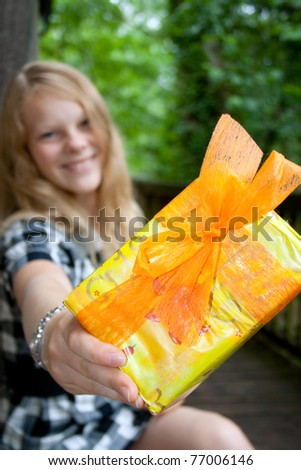 Lady showes present - stock photo