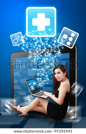 Lady use notebook computer and First Aid icon from tablet pc - stock photo
