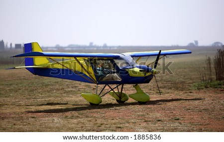 Lady visable in the cockpit of a light aircraft. - stock photo