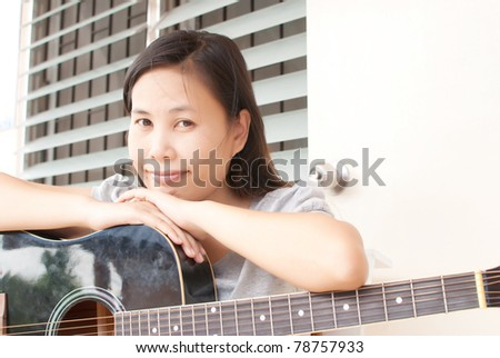 Lady with classic acoustic guitar. - stock photo