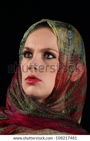 Lady with green and red silk scarf wrapped around her head - stock photo