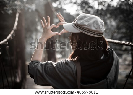 lady with hands forming a heart shape - stock photo
