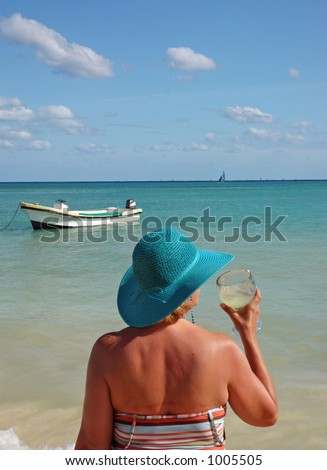 Lady with Margarita at the Beach - stock photo