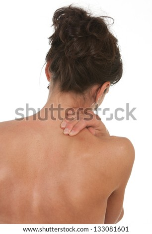 Lady with neck and shoulder pain. Shot against white background - stock photo
