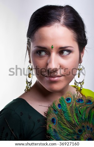 lady with peacock fan - stock photo