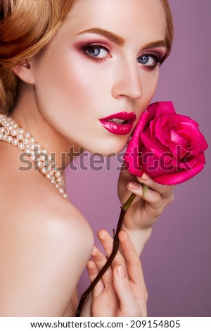 Lady with pink rose - stock photo