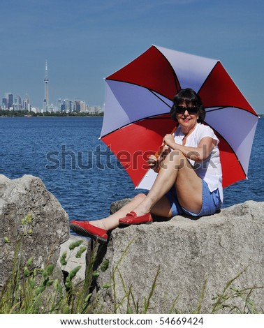 Lady with umbrella against Toronto SKyline