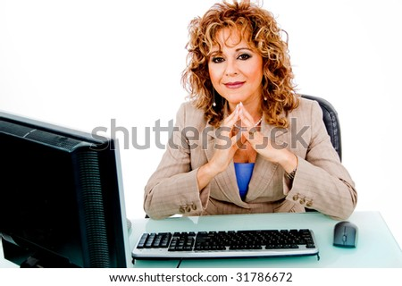 Lady working in her office on laptop - stock photo