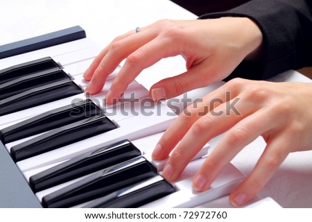 Ladyhands on piano keys - stock photo