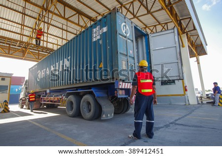 LAEM CHABANG -MARCH 10 : Containers checking condition at Laem Chabang commercial port on March 10, 2016 in Laem Chabang, Thailand - stock photo