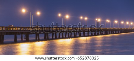 Laem Sok Pier lit up by street lights at dusk in Trat Province, east Thailand. This is the mainland ferry terminal for Ko Kut and Ko Mak islands.