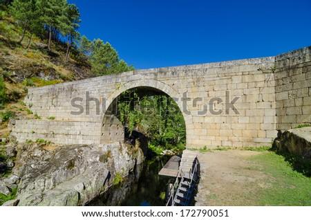 Lagarica medieval granite stone bridge in Resende, north of Portugal. - stock photo
