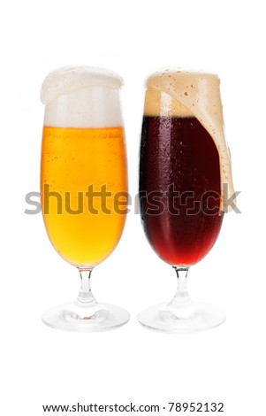 Lager and dark cold beer in glasses isolated on white background. - stock photo