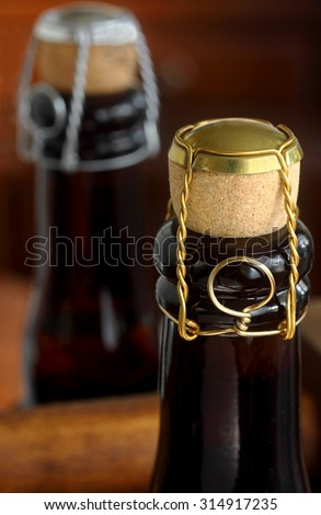 Lager beer bottles corked in the Belgian tradition - stock photo