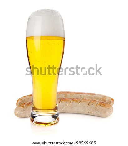 Lager beer glass and two grilled sausages. Isolated on white background - stock photo