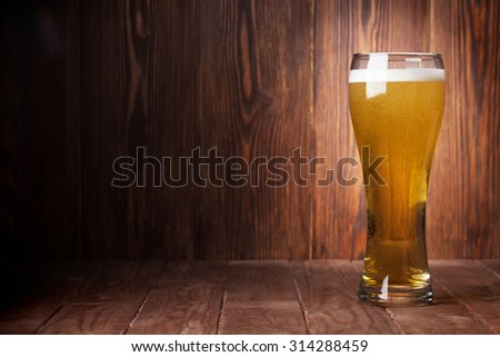 Lager beer glass on wooden table. View with copy space