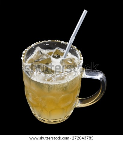 Lagerita is a cocktail that contains tequila, Cointreau, lime juice, beer in a salt-rimmed glass. Isolated on black. - stock photo