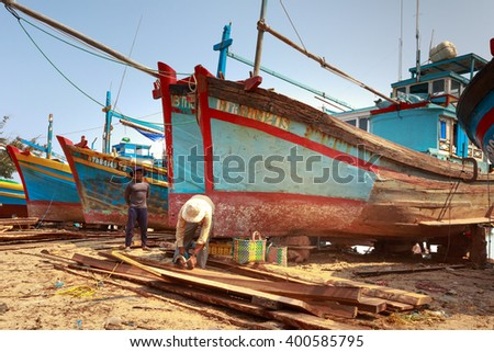 Lagi beach, Binh Thuan province, Vietnam - March 28, 2016 : at a repair workshop fishing boats. Skilled workers are repairing fishing boats for fishermen