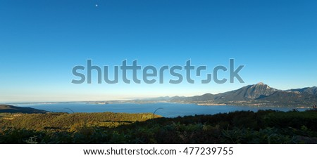 Lago di Garda (Garda Lake), the largest Italian lake of glacial origin. The Veneto coastline in the foreground in the background the coast of Lombardy