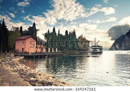 Lago di Garda lake near resort Malcesine with mountains as a background  - stock photo