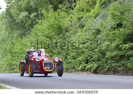 LAGO DI VICO (VT), ITALY - MAY 16: A red Benedetti Giannini 750 S takes part to the 1000 Miglia classic car race on May 16, 2015 near Lago di Vico. The car was built in 1950. - stock photo