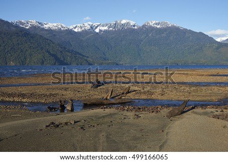 Lago Yelcho in the Aysen Region of southern Chile. Large body of fresh water surrounded by lush forest and snow capped mountains.