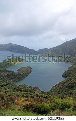 Lagoa do Fogo or in English: Lagoon of Fire is a crater lake within the Agua de Pau stratovolcano in the center of the island of Sao Miguel Island in the Azores - stock photo