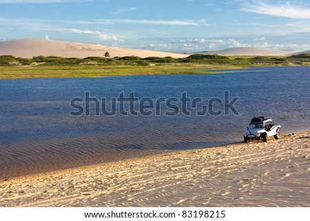 Lagoon at the foot of dunes in the remote town of Jericoacoara in northeast Brazil - stock photo