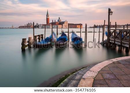 Lagoon, Gondolas and San Giorgio Maggiore Church in Venice, Italy - stock photo